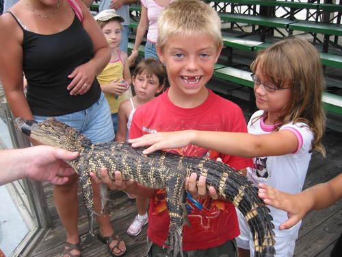 Brandon holding a crocodile